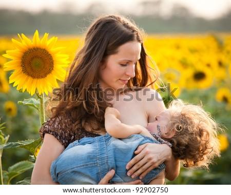 African Women Breastfeeding Animals
